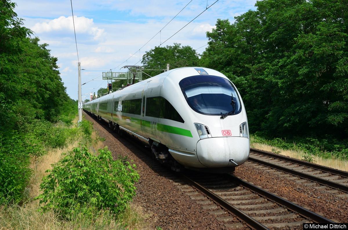 411 057 als ICE 1711 und 411 064 als ICE 1601 kurz vor dem Bahnhof Lichterfelde Ost.